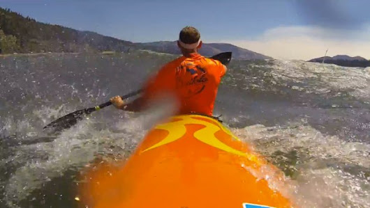 Big downwind in a river | Global Surfski