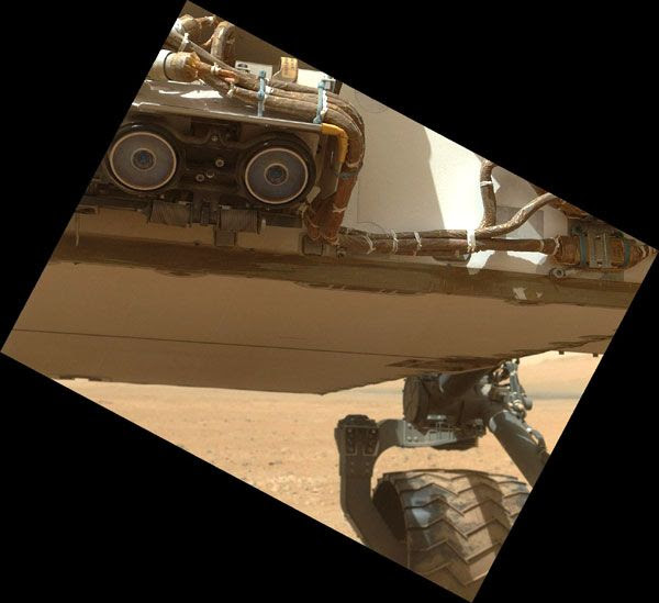 A MAHLI image of the Curiosity rover's underbelly and two hazard avoidance cameras, taken on September 9, 2012.