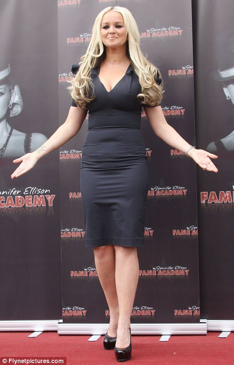 Tight squeeze: Jennifer Ellison showed off her four stone weight loss in a tight black dress as she opened her Fame Academy in Liverpool in June