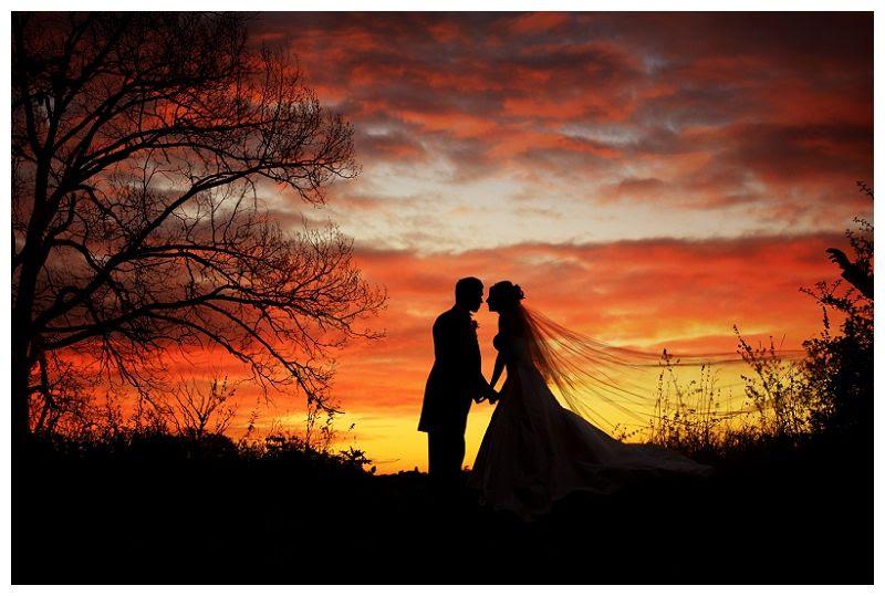Weddings at Fanhams Hall 23, Sunset wedding silhouette of couple at Fanhams Hall
