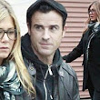 Hiding anything Jennifer? Aniston fuels pregnancy speculation as she covers up in oversized coat... and clears her schedule for rumoured baby
