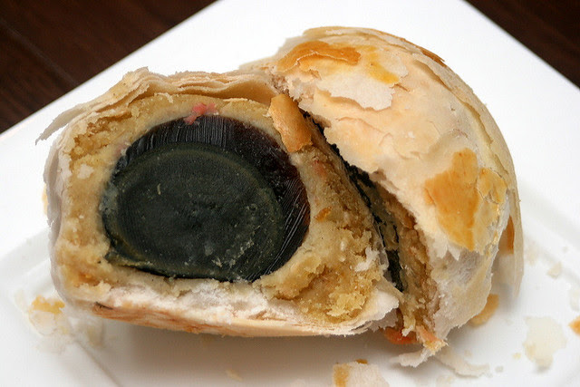 Pastry with century egg in mixed nutty paste