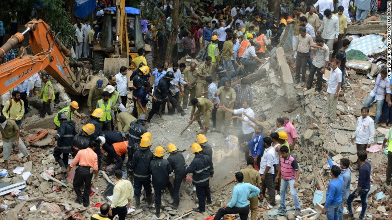 Rescue workers look for survivors in debris at the site of a building collapse in Mumbai on Tuesday.
