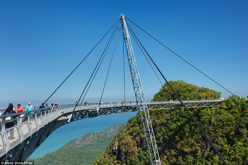 Completed in 2004, the Langkawi Sky Bridge is built on top of the Machinchang mountain in Malaysia and hangs at about 328 ft above the ground. The walkway can accommodate up to 250 people at the same