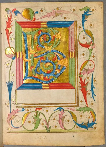 Large detailed illuminated letter and surrounding arabesque decoration
