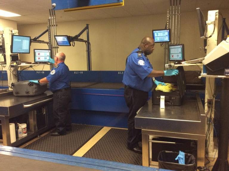 TSA security workers open and inspect baggage at Myrtle Beach International Airport that have been pre-screened by computer imaging workers. That technology helps signal when the bag contains a suspicious item.