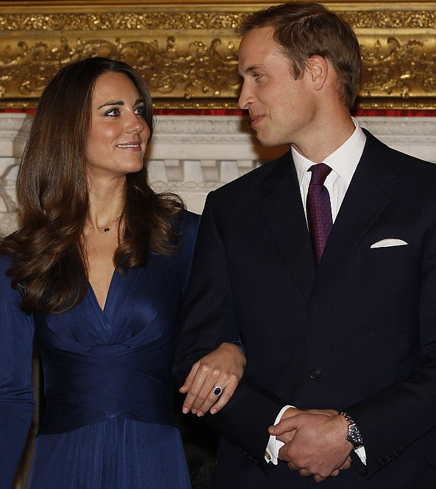 Look of love: Kate Middleton gazes into the eyes of Prince William as the couple met the press yesterday
