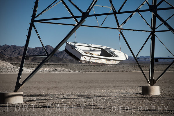 S.S. Vickers, boat suspended from high tension power line pylon in the middle of the Mojave Desert