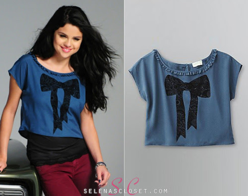 Selena Gomez let her hair down for a fun, vacation-themed photo shoot for her own label Dream Out Loud's Fall 2012 Collection. In this shot she wore a Dream Out Loud Junior's Flocked Bow Crepe Blouse in Moroccan Blue. This top is also sold in white and pink (our favorite is the Pearl Ivory!), and can be yours for an easy $12.00 from Kmart.com! Buy it HERE. Check out the commercial for her new DOL range, available in Kmart now!