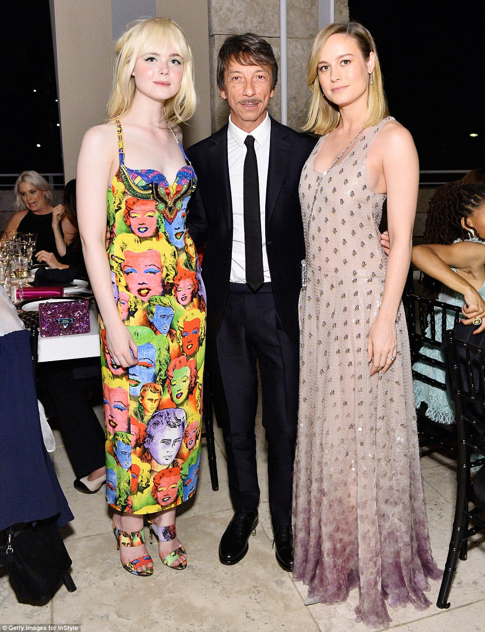 Tasteful trio: Elle, Award winning designer Pierpaolo Piccioli and Brie Larson posed looking glamorous