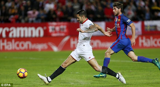Vitolo handed Sevilla the lead after a quarter of an hour as he escaped Sergi Roberto (right)