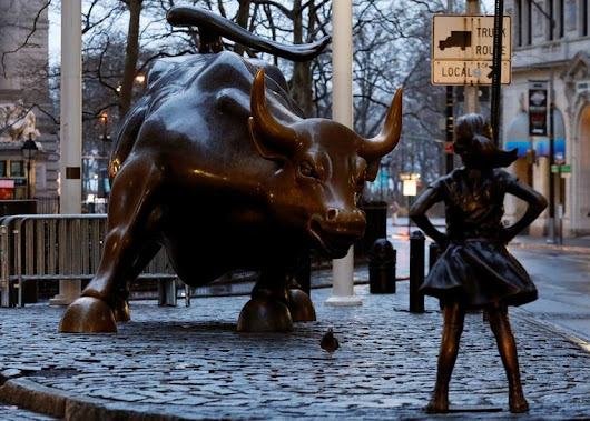 On Women's Day eve, statue of girl stares down Wall Street bull
