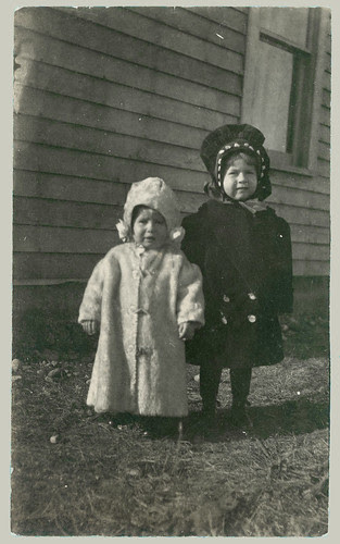 Two children in winter coats