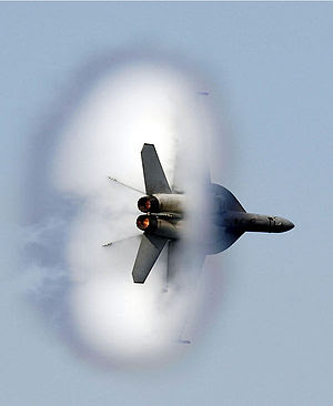 """An F/A-18F Super Hornet assigned to the """"..."""