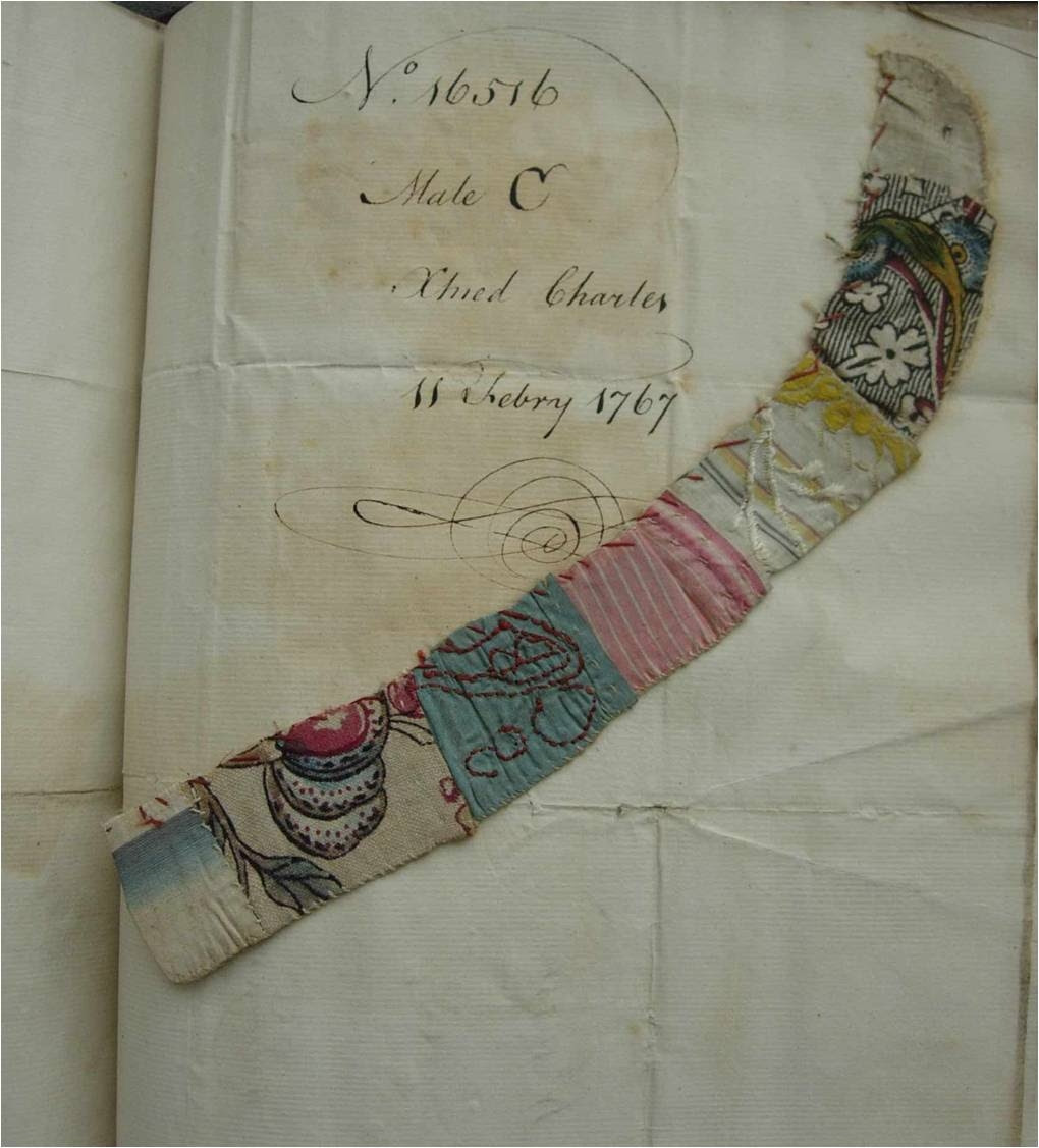 A strip of patchwork made from pieces of woven silk and printed cotton or linen, embroidered with a heart and cut in half, left at the Foundling Hospital, as an identifying token with a baby boy christened Charles on 11 February 1767