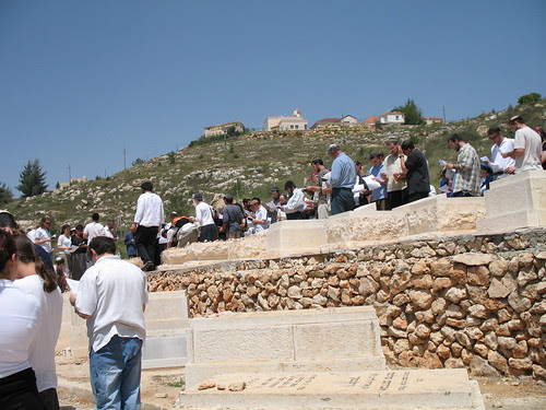 saying psalms at the graves of the terror victims and soldiers
