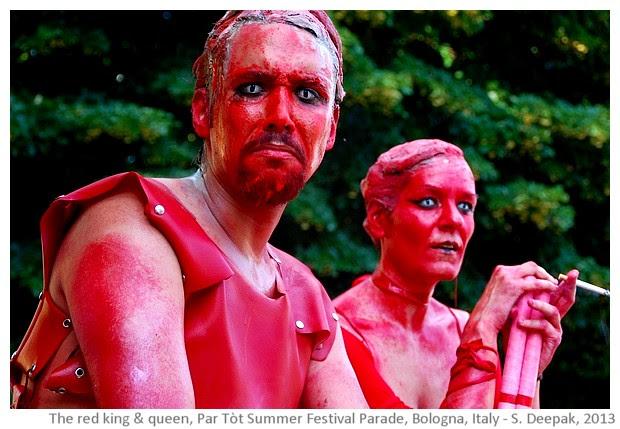 Red stilt dancers, Partot summer parade, Bologna, Italy - images by Sunil Deepak, 2013