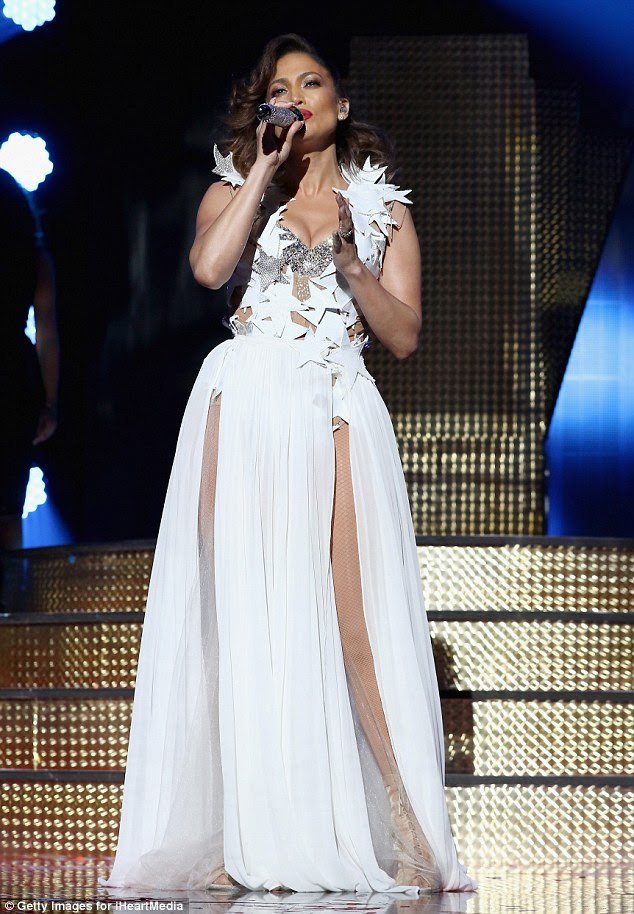 Elegant:To start the show, the recording icon showed up in what appeared to be a floor length white skirt, with two daring slits up legs