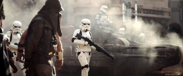 Supported by an Imperial hover tank, Stormtroopers patrol the area in ROGUE ONE: A STAR WARS STORY.