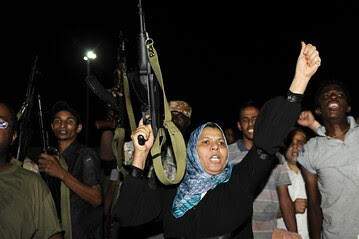 Armed supporters of the Libyan government defend their revolution from the western-backed rebels who have been trapped in several areas of the capital of Tripoli. Despite claims by the corporate media the TNC forces do not control Tripoli.  by Pan-African News Wire File Photos
