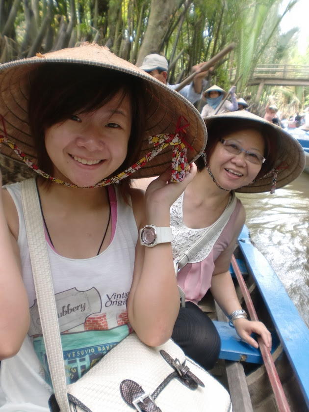 Mum and I doing it the traditional way, donning on the Vietnamese hats. Somewhere in Saigon/Ho Chi Minh City, Vietnam
