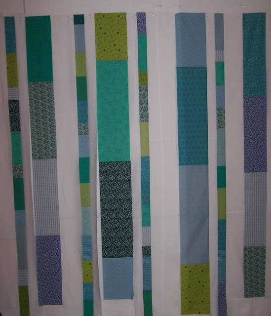 Blues Greens Strip Quilt on Wall
