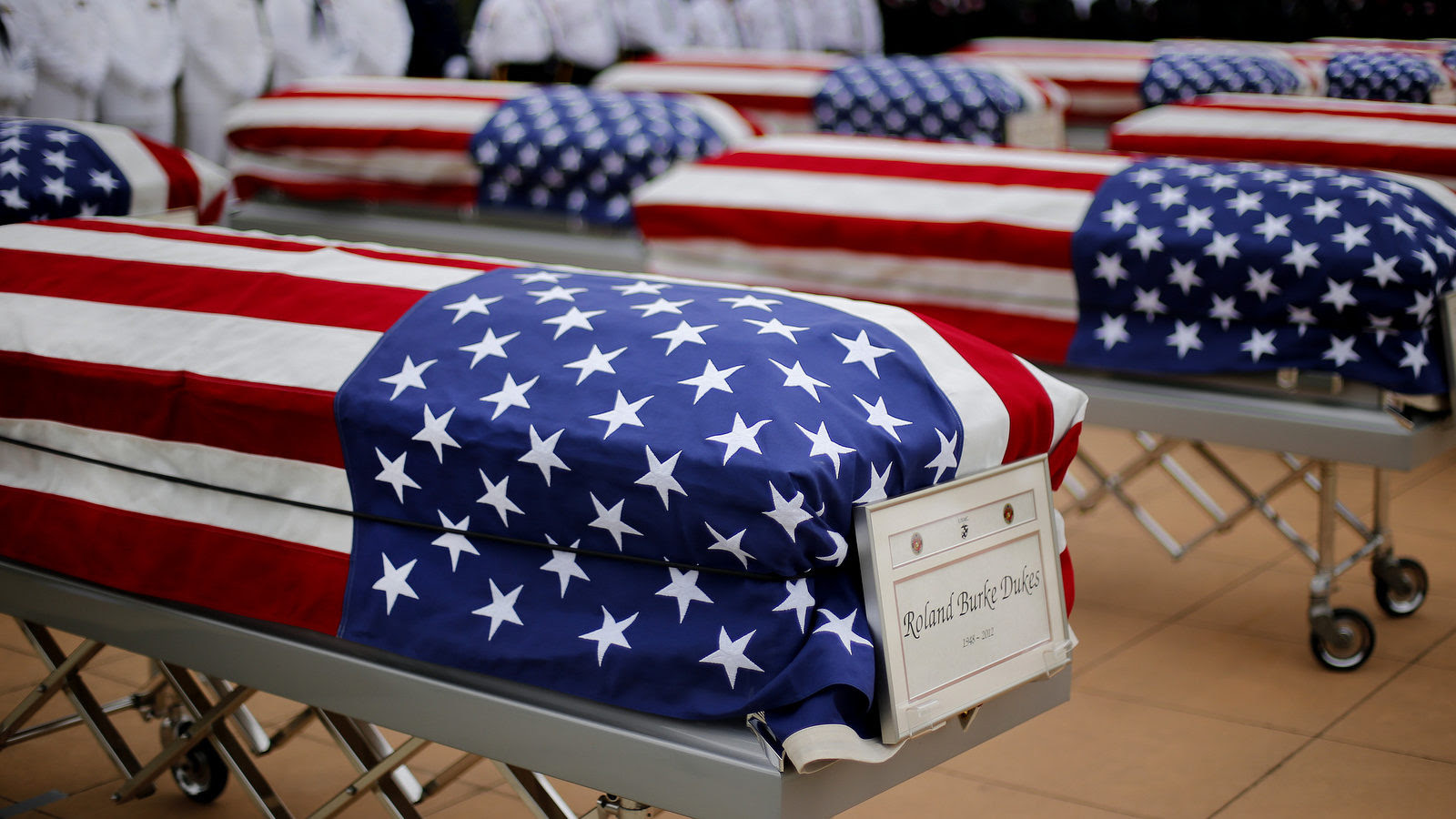 The flag draped casket of Roland Burke Dukes is shown during a memorial service and burial at Great Lakes National Cemetery in Holly Township, Mich., Thursday, Sept. 11, 2014. Thirteen military veterans whose remains went unclaimed at a Detroit morgue finally have been laid to rest. (AP Photo/Paul Sancya)