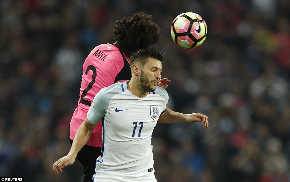 Lallana gets up to win the ball ahead of Anya, who was used as an attacking full back in a positive Scottish line-up