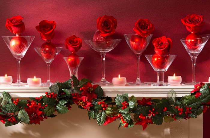 Sometimes simplicity makes the biggest impact. This Christmas mantel is dressed with common martini glasses with an inset of ornament and rose surrounded by petite votives and draped with a garland of traditional mistletoe.