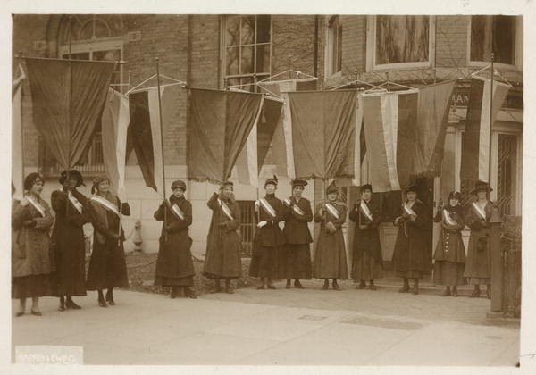 The first suffrage picket line leaving the National Womans Party headquarters to march to the White House gates on January 10, 1917.