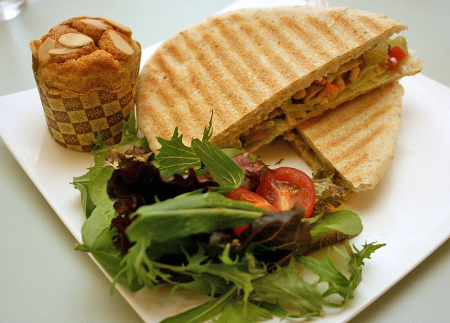 Crisp wholemeal panini with vegetables and sauteed mushrooms. Top left: wholewheat olive oil orange cake
