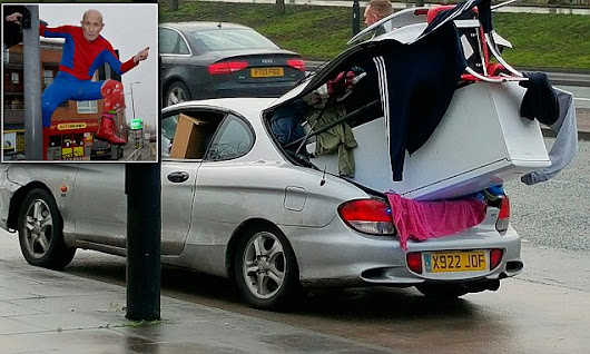 Car with FRIDGE sticking out of the boot is stopped by police