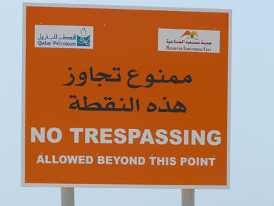 Sign reads: No Trespassing Allowed Beyond This Point