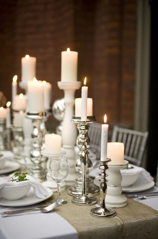 Rustic and lovely! Silver and white candlesticks with burlap table runner. Beautiful for party center piece in summer or at the beach also.