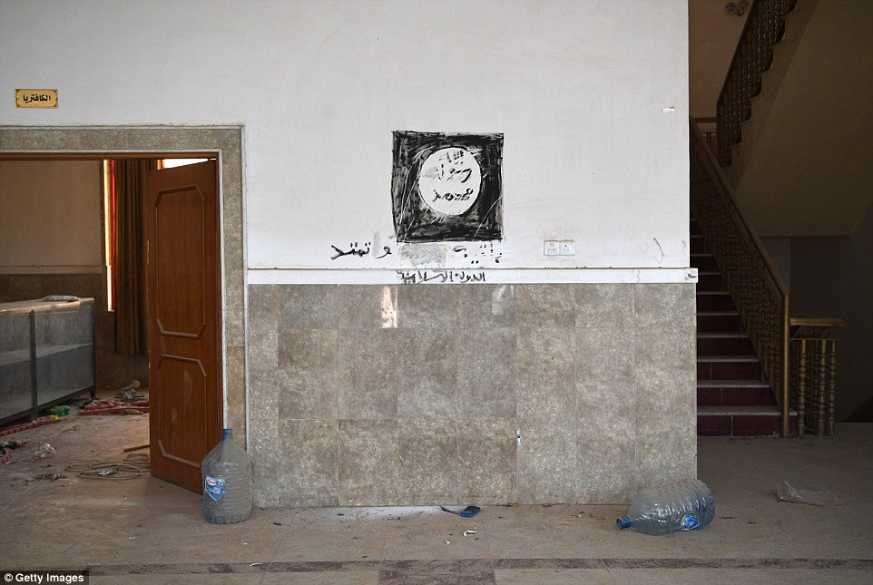 An Islamic State flag is painted on the wall of a church in the predominantly Christian town of Bartella during the occupation by ISIS