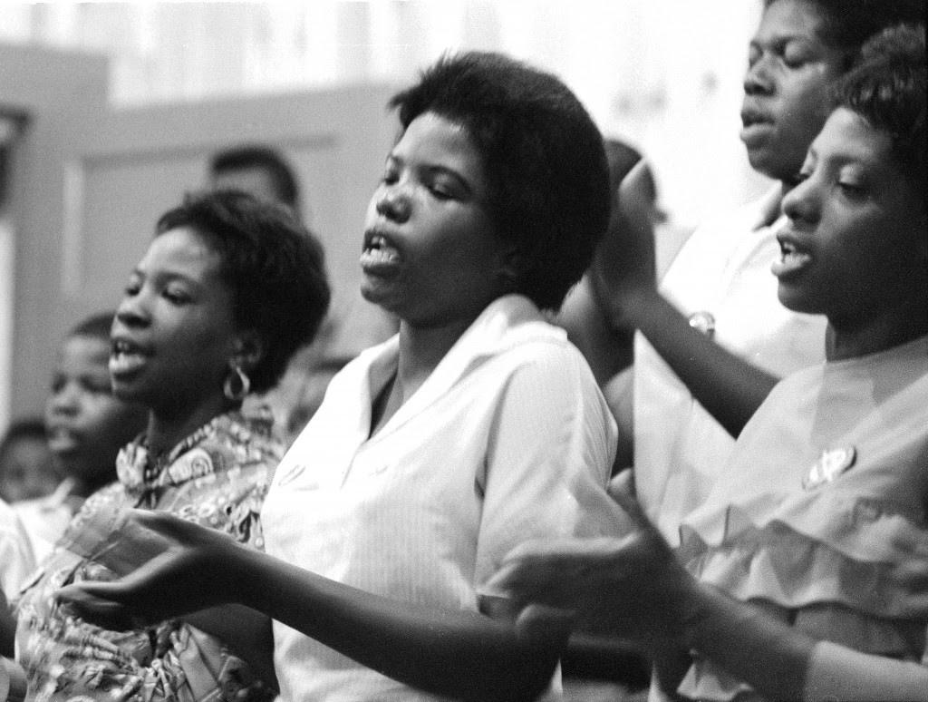 Young women singing freedom songs in a Selma church. 7/8/1964. Photo by Matt Herron/Take Stock Photos.
