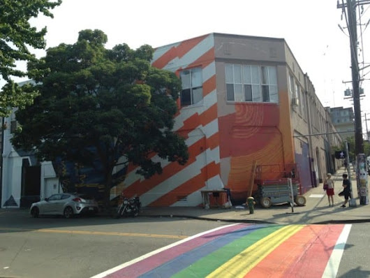 Massive 'Read up, Hands down' mural rises at 12th/Pine's Richmark Label building