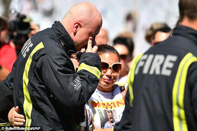 Mr Ali said: 'As we know in Grenfell, many innocents were murdered by Theresa May's cronies'. Pictured: A firefighter weeps after the disaster
