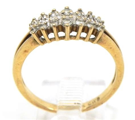 ladies  yellow gold  rows diamonds wedding ring
