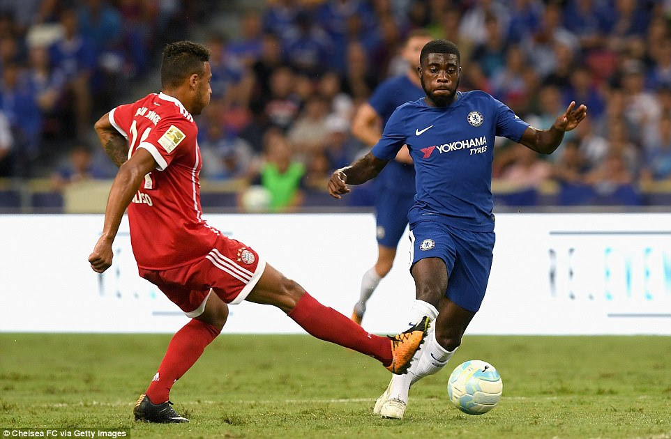 Jeremie Boga of Chelsea attempts to get past Corentin Tolisso of Bayern Munich during an entertaining opening period