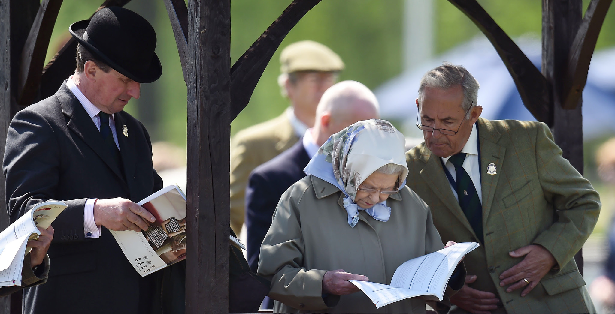 Queen Elizabeth II studies the programme as she attends the third day of the Royal Windsor Horse Show, which is held in the grounds of Windsor Castle in Berkshire. PRESS ASSOCIATION Photo. Picture date: Thursday May 12, 2016. Photo credit should read: Andrew Matthews/PA Wire