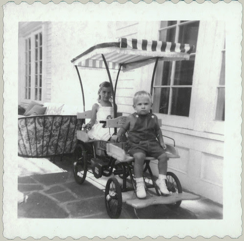 Two children on a wagon