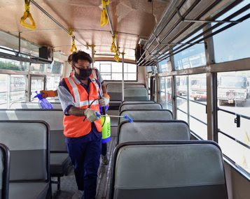 Workers conduct a cleaning drive in buses as part of a precautionary measure against the novel coronavirus (COVID-19) outbreak, at ISBT Anand Vihar, New Delhi. PTI