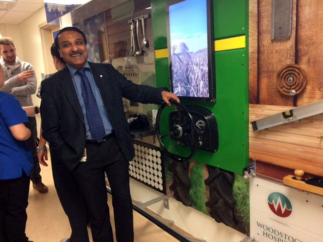 Geriatric psychiatrist Dr. Shabbir Amanullah shows off a new interactive wall at Woodstock Hospital Tuesday afternoon. (HEATHER RIVERS/WOODSTOCK SENTINEL-REVIEW)