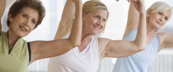 older person doing yoga