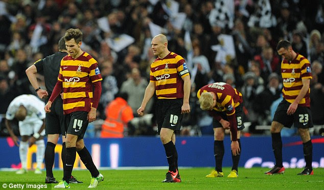 Downbeat: Bradford City players look dejected after their defeat