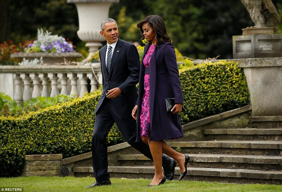 Departing: Mr and Mrs Obama on the lawn of Winfield House, the US ambassador's official residence in London, this morning