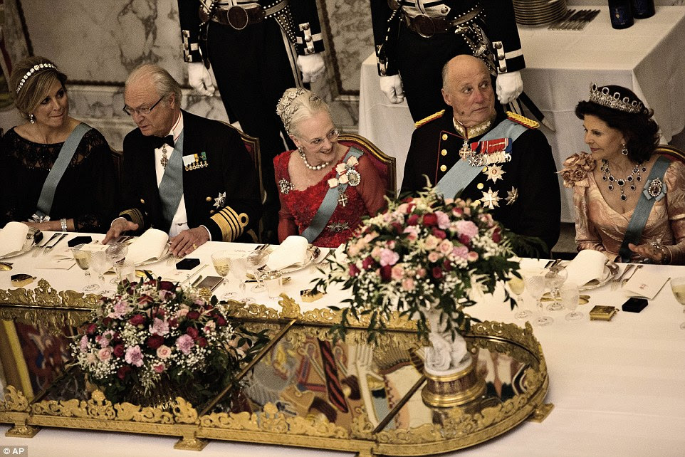 Cheers! Queen Margrethe sits between King Carl XVI Gustaf of Sweden and King Harald of Norway