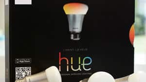 Philips's lighting system Hue, controllable through iPhones and iPads, goes on sale Tuesday in Apple stores.