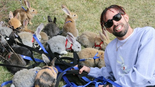 'They multiply fast,' says Calgary man, corralling 31 bunnies for Easter Sunday walk